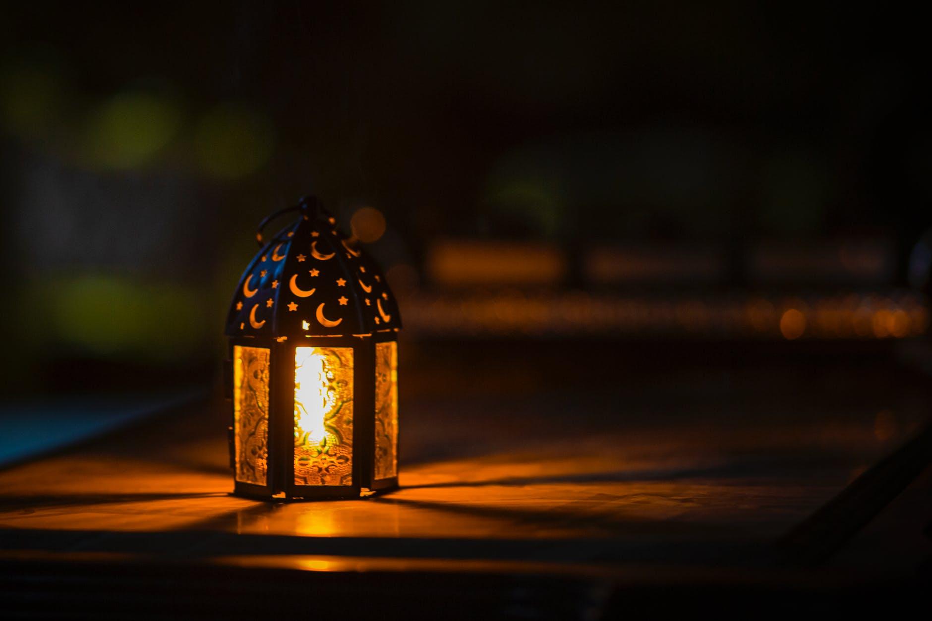 photo of ramadan light on top of table