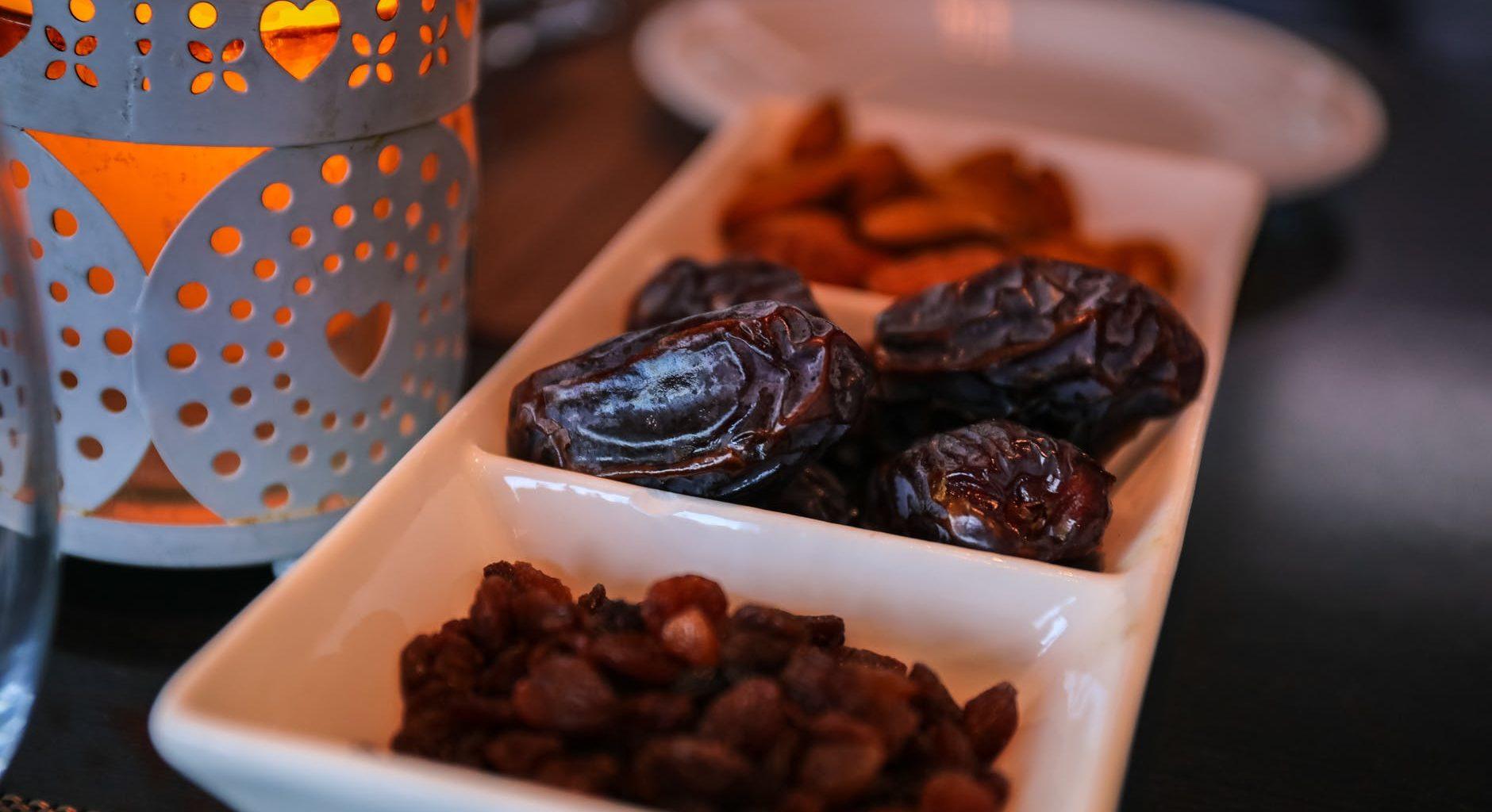close up photo of raisins and dates