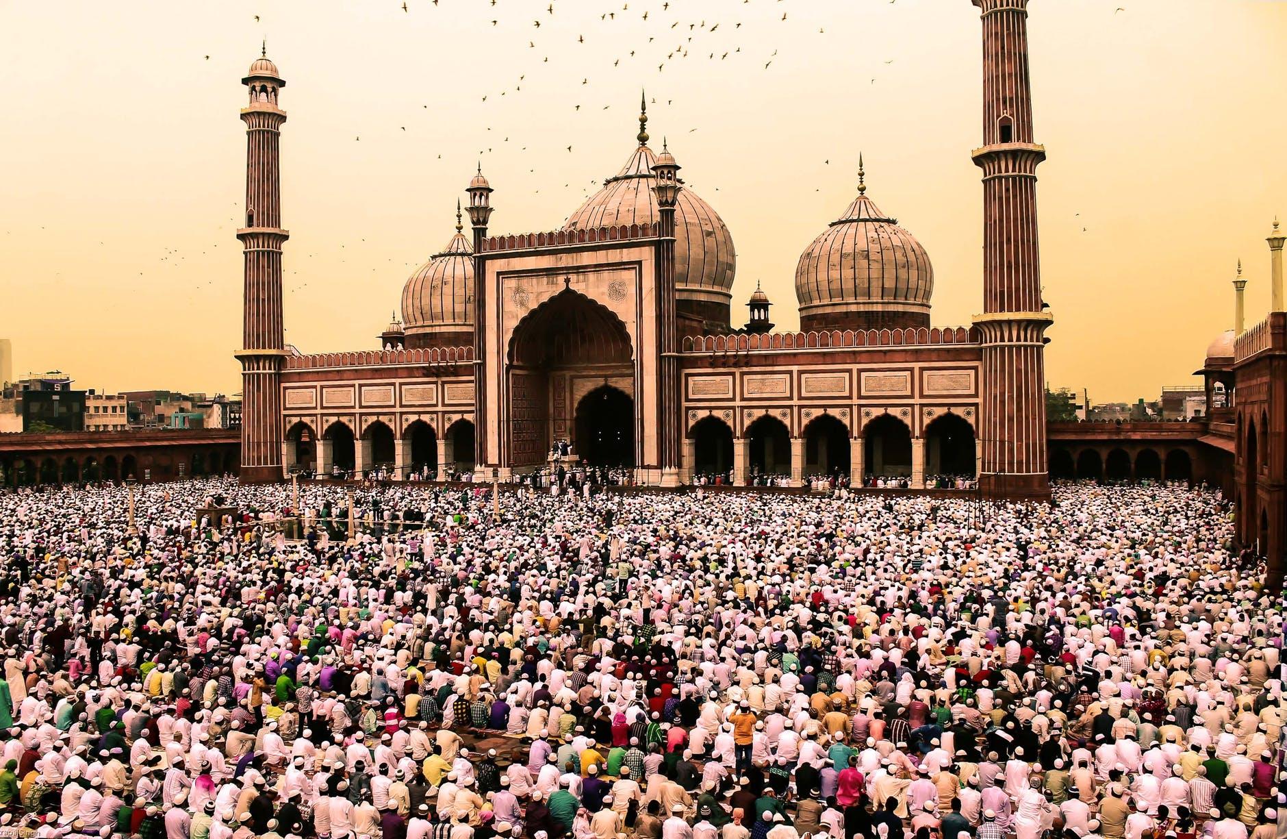 photo of crowd of people gathering near jama masjid delhi
