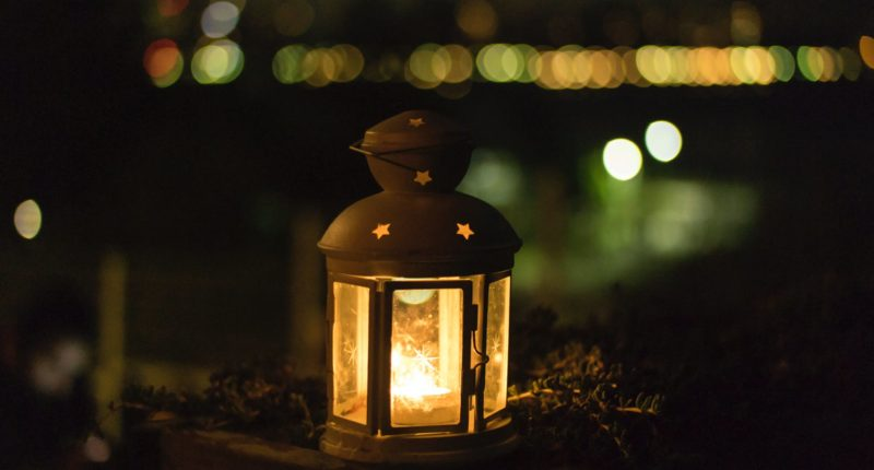 photo of yellow lantern during night