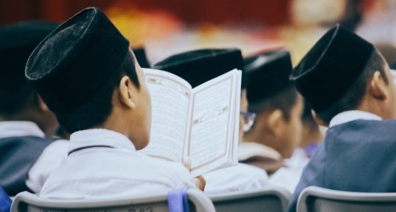photo of person reading quran