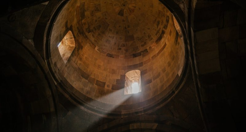 old domed ceiling with sunlight shining through window